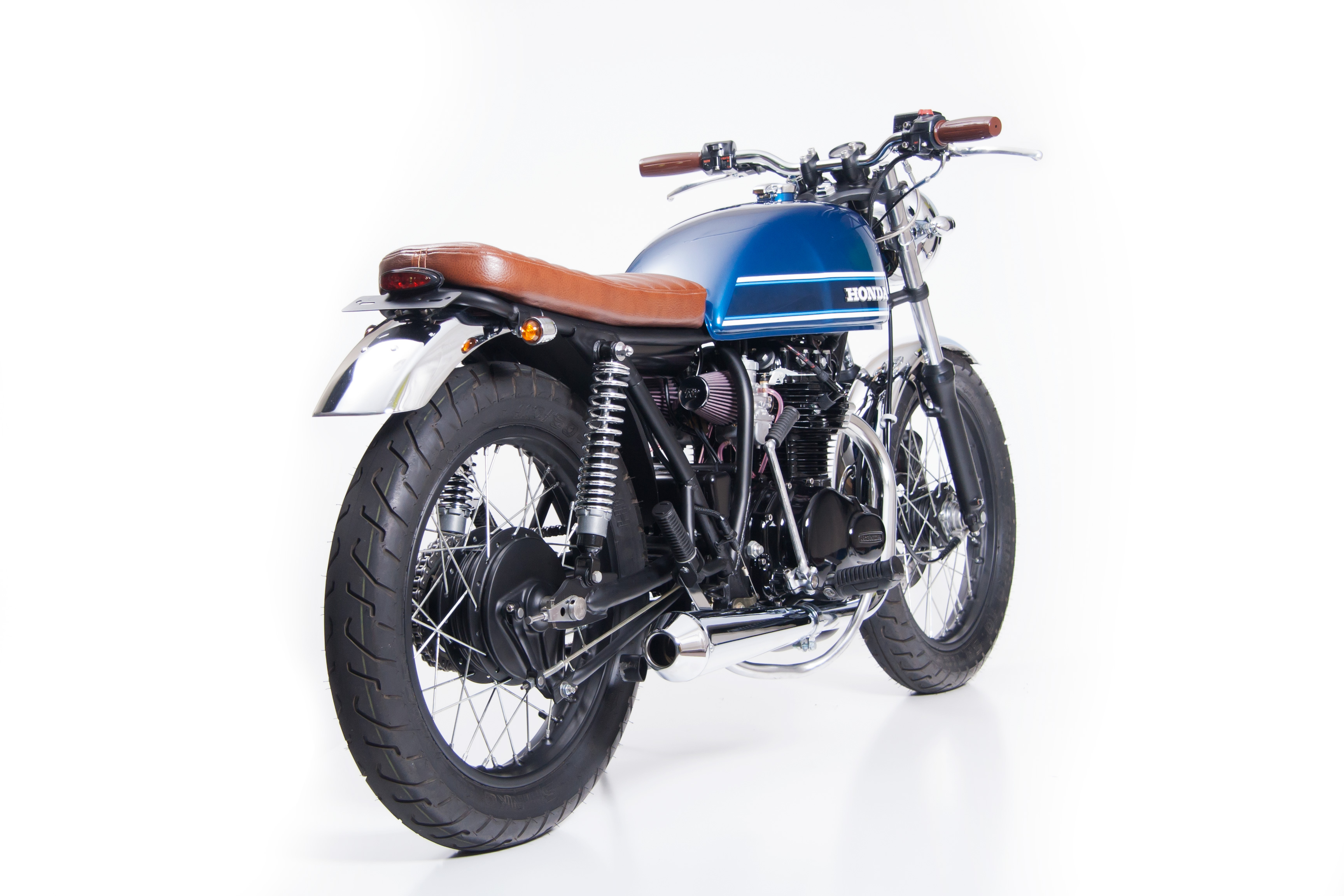 Custom exhaust, seat, fenders, controls and much more on this 1976 Honda CB360T