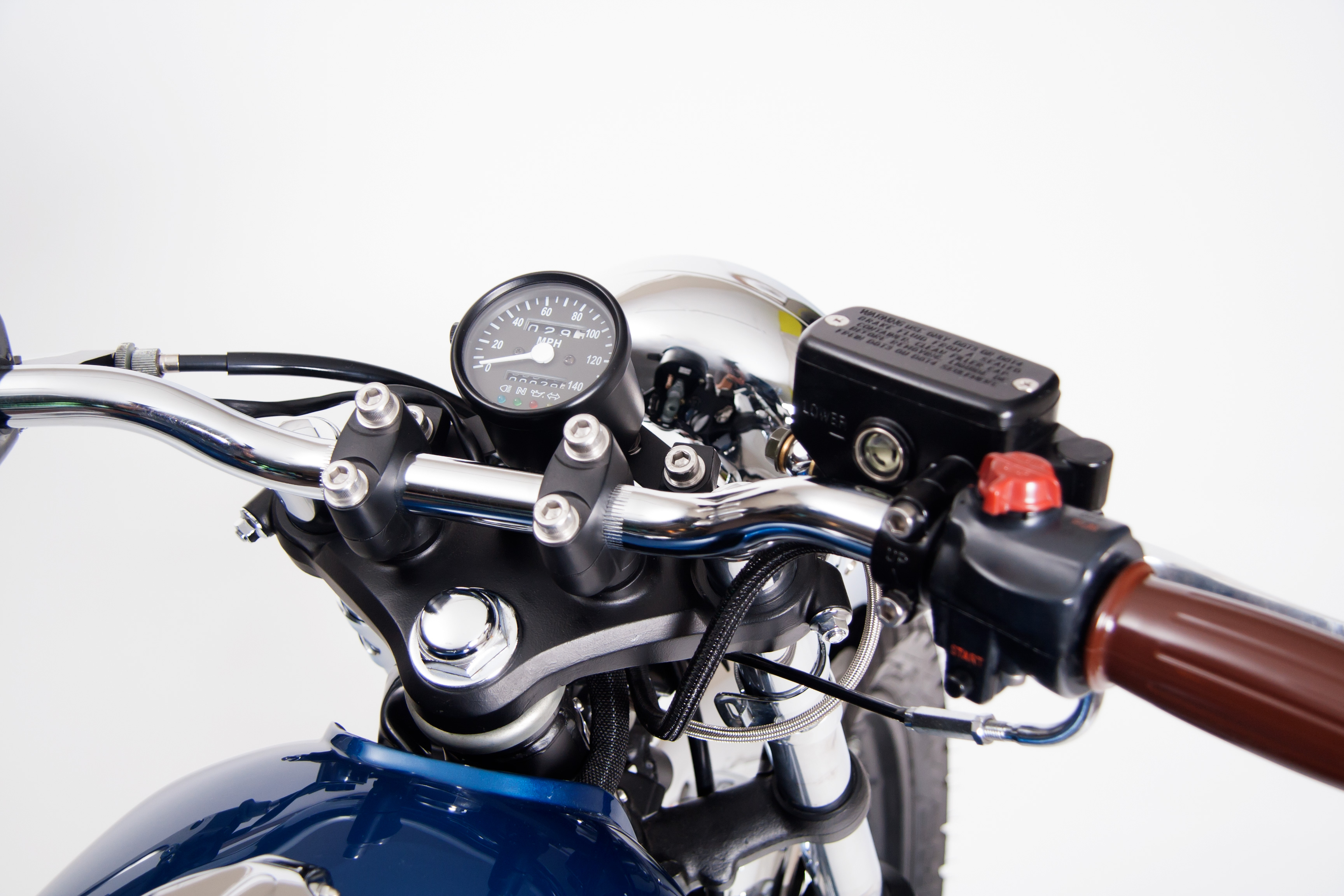 Custom controls and a small speedometer on a 1976 Honda CB360T