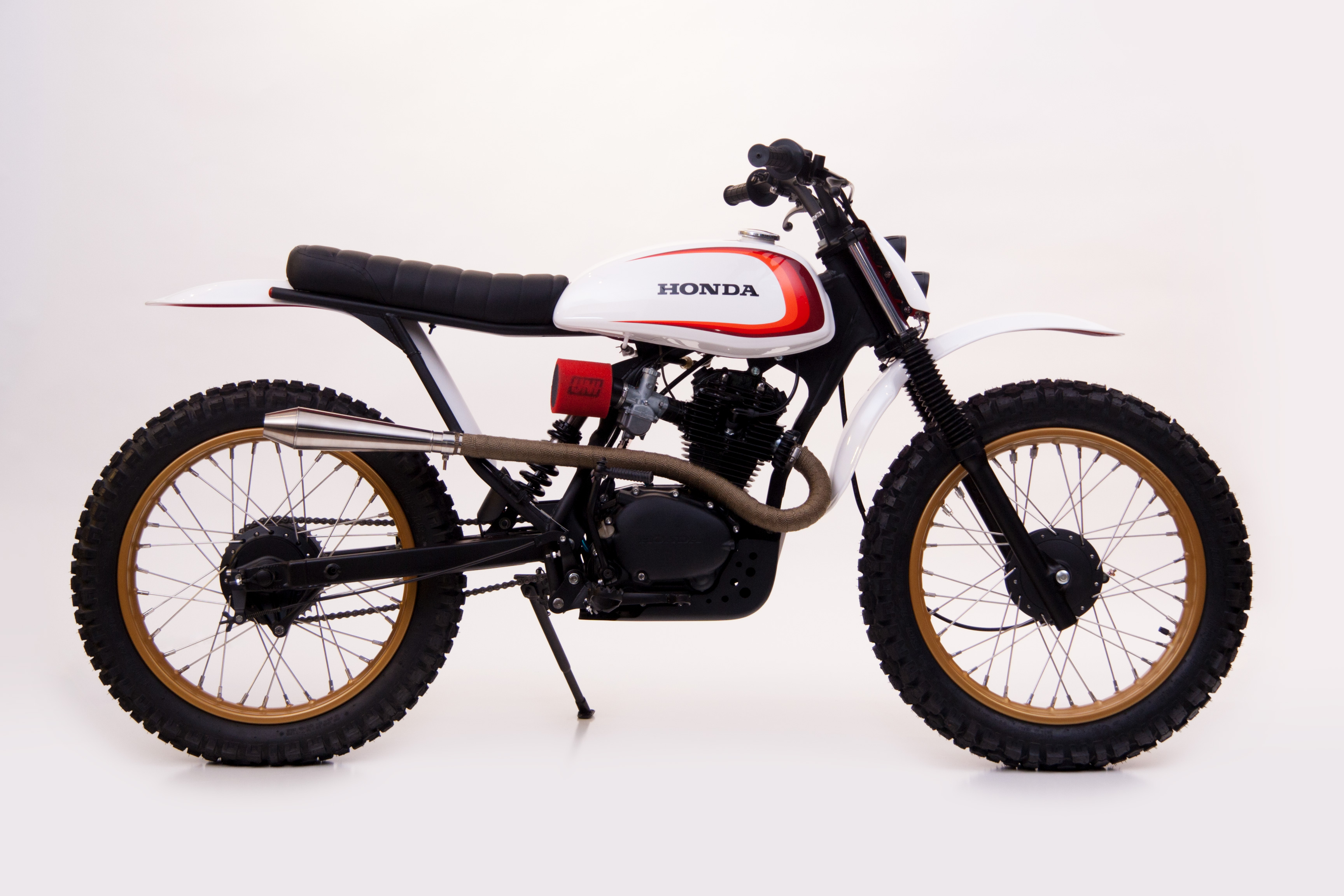 Honda SL125 with 18″ wheels, stainless steel spokes, and dual sports tires